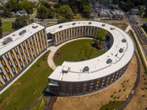 Aerial shot of backwards C shape of Holly Pointe Commons residence hall.