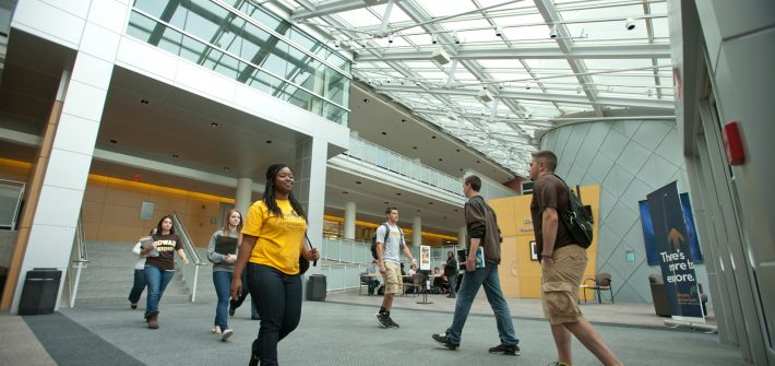 seven students walk through Science Hall