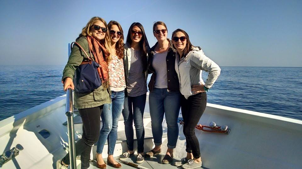 Study abroad friends on a boat trip in Italy
