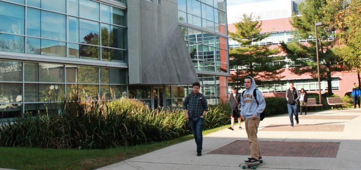 Students rush to classes on Monday morning passing Savitz Hall