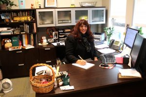 Public Relations advisor Lori Block working in her office.