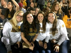 Rowan Students in the crowd of a Football game