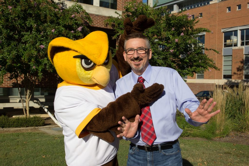 Sr VP Jeff Hand strikes a pose with the Rowan Prof Whoo RU