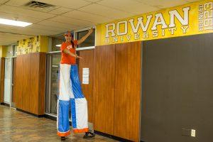 Rowan grad on stilts an Rowan Banner