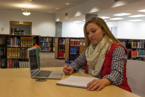 Student works on homework in library