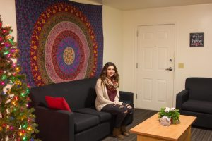 student sits in townhouse
