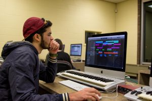 student works on audio project