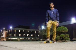 student and his longboard