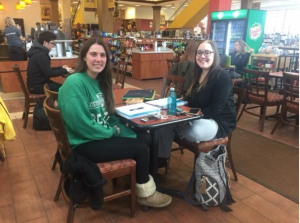two students sit studying for finals
