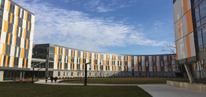 exterior of Holly Pointe Commons, orange, white and gray modern