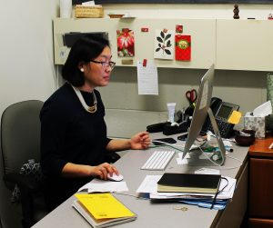 Dr. Li Yang works at her desk in the Rowan's International Center