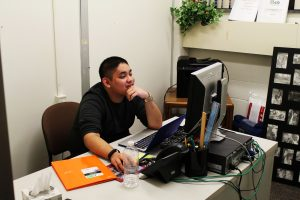 Arthur Bautista working at the Rowan's International Center
