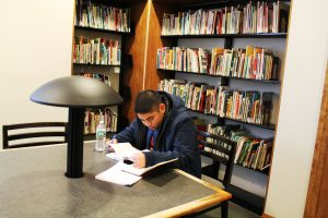 Political Science Major Andrew Bautista studies at the Campbell Library