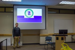 student leads honor society meeting