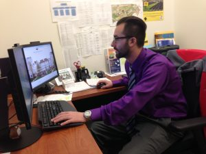 Academic advisor works at his desk