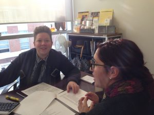 Academic advisor Rachel Budmen meets with a student in her office.