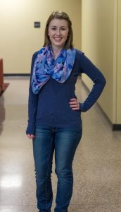 student portrait of education major standing with her hand on her hip