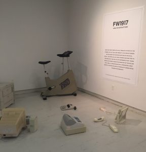 outdated technology arranged to show how media affects people, including typewriters and old treadmill