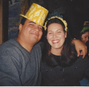 Julie and Bernard in college, with Bernard wearing a yellow hat