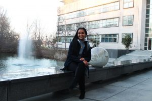 Rowan Student Tsion Abay behind the Engineering Building next to the fountain