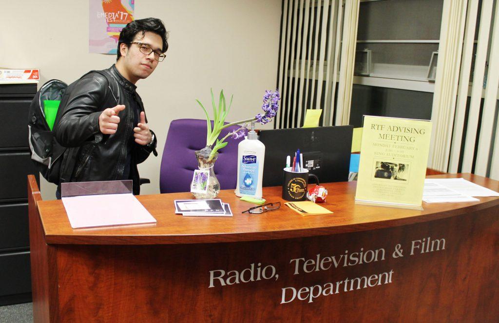 Rowan RTF Student Frank Villarreal behind RTF desk