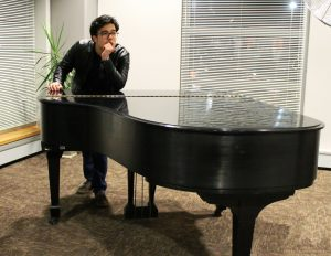 Rowan RTF Student Frank Villarreal sometimes practices playing piano