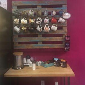 hanging teacups inside Devour Desserts
