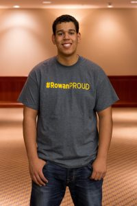 student portrait, Anthony Ramos smiles while wearing a #RowanPROUD tshirt