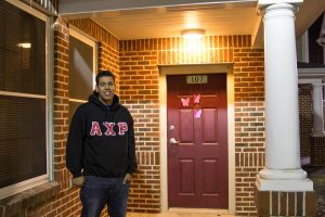 Anthony Ramos wears his Greek AXP letters outside his front door at Rowan Townhouses