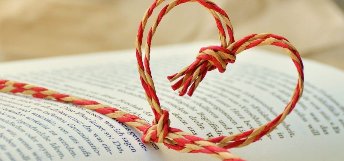 twine in heart shape wraps a book