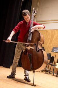 student performs in boyd hall