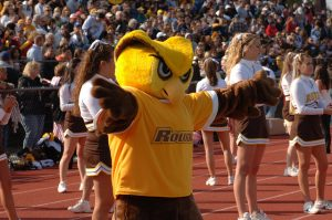 Rowan mascot Whoo RU with arms outstretched at a football game