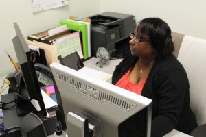 Benita Regusters works behind her desk at Rowan Tutoring Center