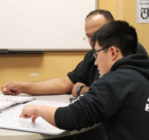 A tutor helps a student at Rowan Tutoring Center