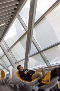 student sits in the engineering building