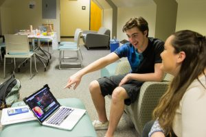 students look at new music in upstair lobby of laurel