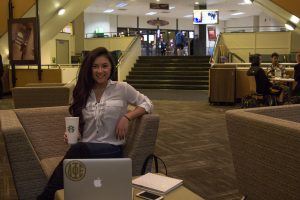 student in student center studying