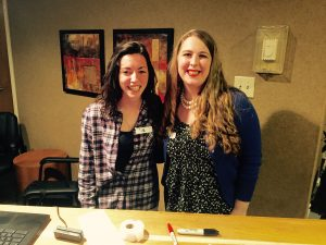 two students in chi alph holiday meeting