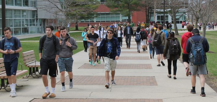 Students walking on Campus in Front of the Savitz Hall