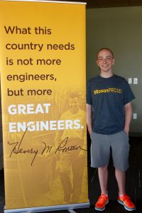 standing next to engineering poster