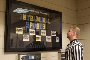Jeff looks at a bulletin board for intramural sports