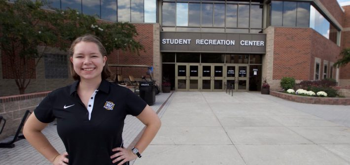 Katie standing outside of the Rec Center