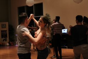 a pair of partners dance face to face in the ballroom.