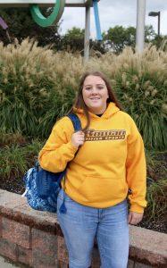 Maribeth with her bookbag outside the Rec Center