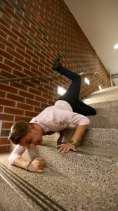 Evan falling down the stairs rushing to class in James hall