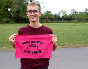 "Kyle holding his ""Rowan fights back"" towel"