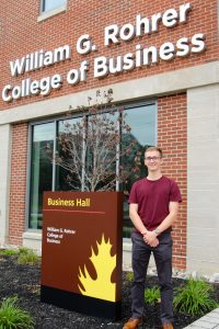 Kyle outside of the Rohrer Business building at Rowan University