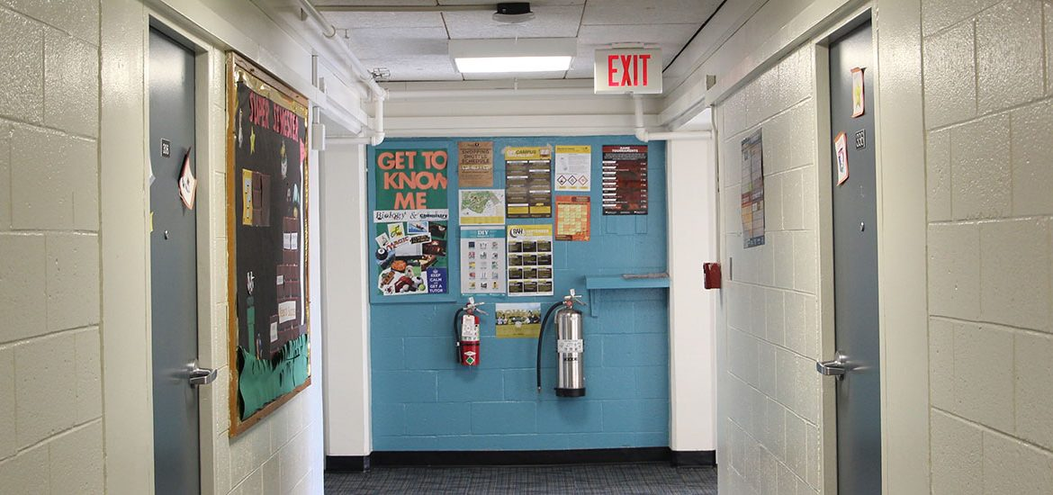 The hallway of Mullica and a brightly colored bulletin board.