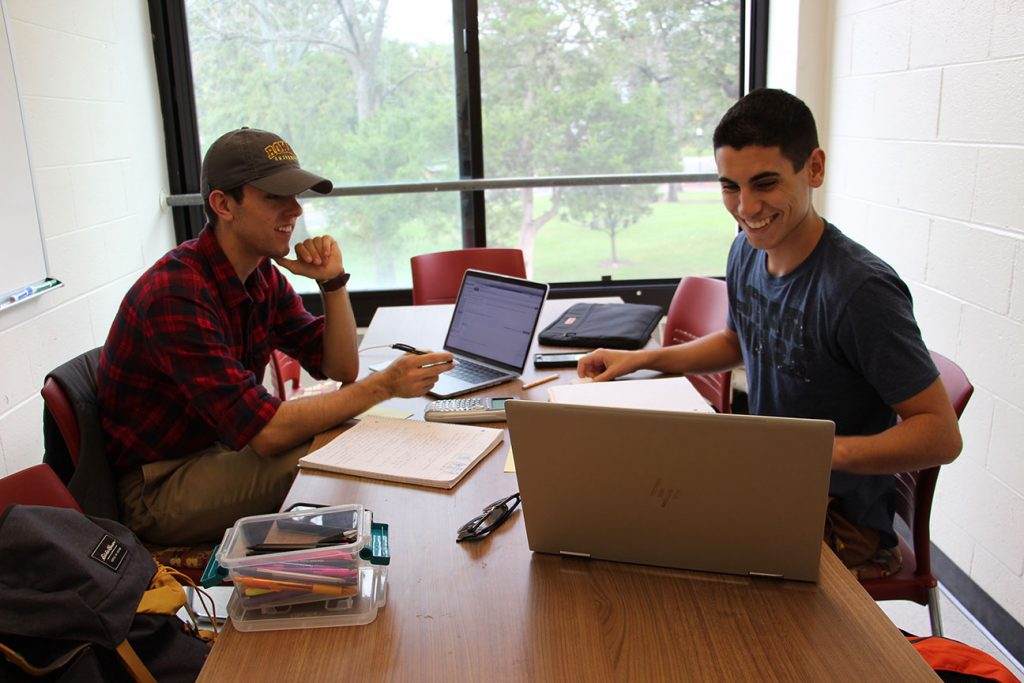 John Martinez (left) and Justin Tavares (right) study in one of Evergreen Hall's study rooms.
