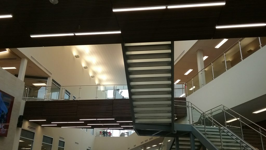 looking up from under the staircase at Rowan College at Burlington County, Rowan University partnership